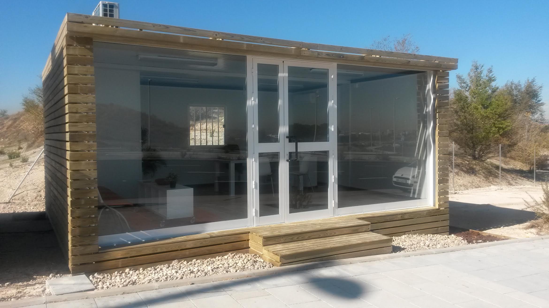 Balat oficina de venta con madera revestida balat - Casetas de exterior ...